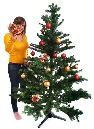 decorating christmas tree: Woman Decorating Christmas tree Stock Photo