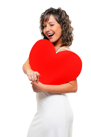 paper heart: Young attractive woman holding red paper heart like a valentine card Stock Photo