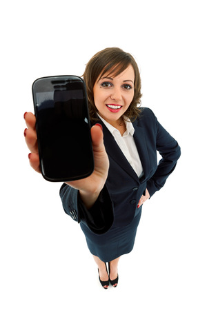 ''wide angle'': Businesswoman holding smart phone isolated on white background shot with wide angle lenses