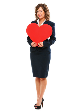 dressing up costume: Businesswoman holding red paper heart like a valentine card