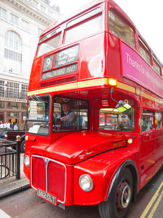 double decker: London, United Kingdom - May 21, 2009 : Red Double Decker Bus in London street near a metro station during the day