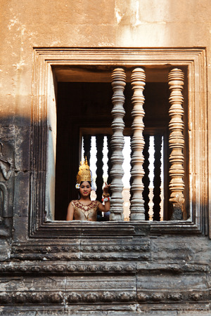 cambodian: Angkor Wat, Cambodia - March 19, 2011 - Woman in traditional Cambodian clothing in Angkor Wat