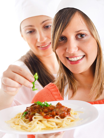 expressing: Cheffs with Spaghetti Bolognese isolated on white, expressing positivity Stock Photo