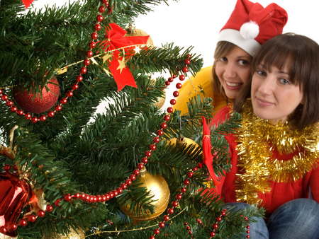 wideangle: Two women near the christmas tree