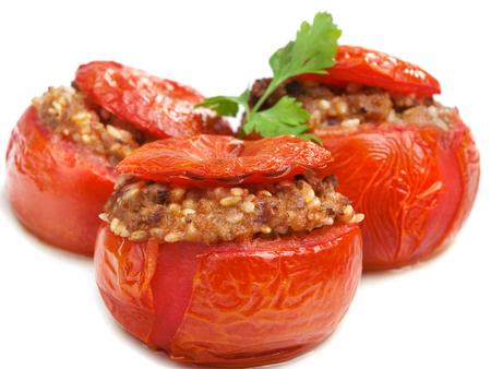 a portion: Stuffed tomato, one portion, close up