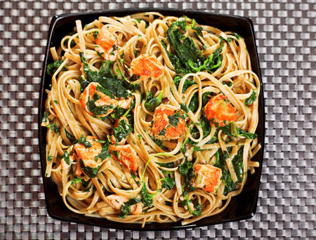 fettuccine: Fettuccine with salmon and spinach, close up
