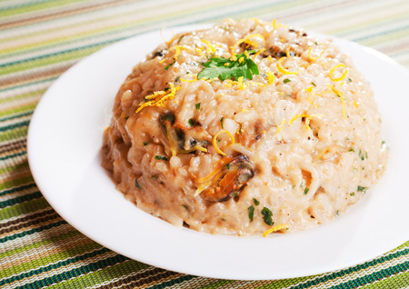 Typical italian recipe for risotto with seafood, one portion