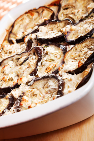 main course: Baked eggplants with cheese and eggs, cooked main course meal in a baking dish Stock Photo