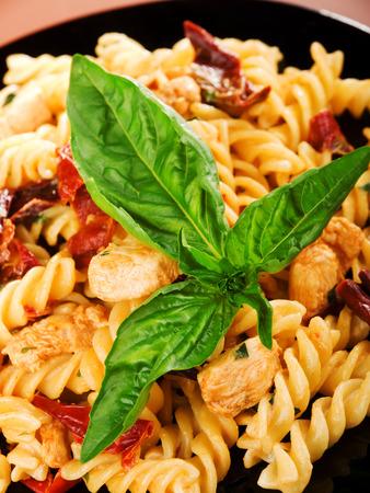 fusilli: Fusilli with salmon and dried pepper, close up Stock Photo