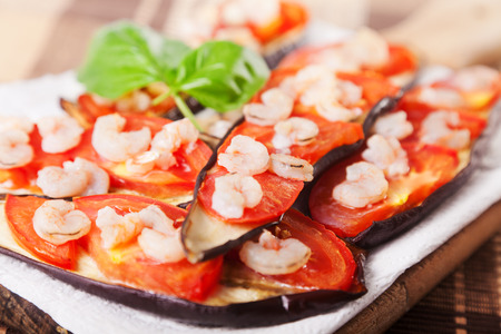 tomato slices: Baked eggplants with tomato slices and shrimps Stock Photo