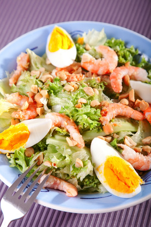 a portion: Mediterranean salad with shrimps and eggs, one portion