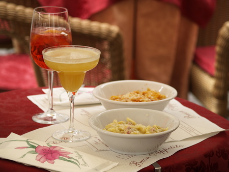 bellini: A typical lunch in Italy - pasta and cocktails. The picture is taken in Verona, near the arena. It contains spaghetti, ravioli, bellini cocktail and shnapps. Stock Photo