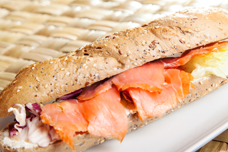 salmon ahumado: Sandwich with smoked salmon and cream cheese, close up