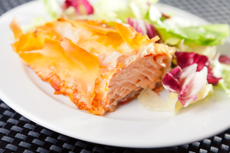 portion: Salmon stewed in phyllo pastry with salad, one portion