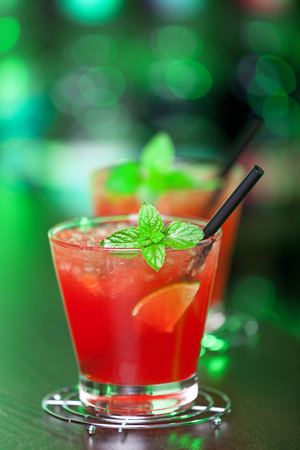 oz: Mai Tai cocktail  Ingredients:   2 oz jamaician dark rum   23 oz triple sec   13 oz amaretto   13 oz sugar syrup   1 dash grenadine (if you prefer it sweeter)   juice of 1 lime   1 spent lime shell for decoration   mint leaves Stock Photo