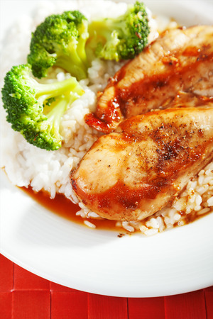a portion: One portion chicken with rice and broccoli Stock Photo