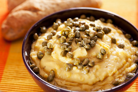 e pretty: Fava is typical Greek dish - it is a purée of yellow split peas. Fava is an easy dish to make and its bright yellow color is a pretty addition to any table. It can be served as an appetizer, meze, or a side dish. Usually it is served with olive oil and c