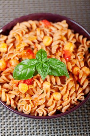 fusilli: Fusilli with chick-peas, close up Stock Photo