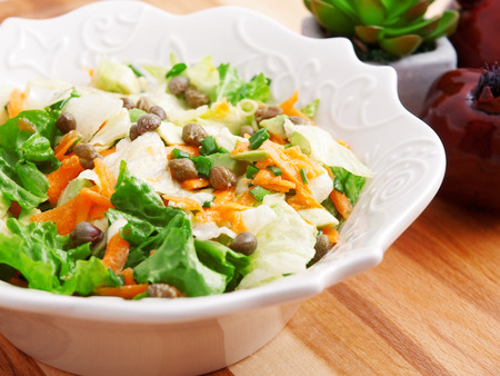 a portion: Salad with carrots, arugula and capers, one portion Stock Photo