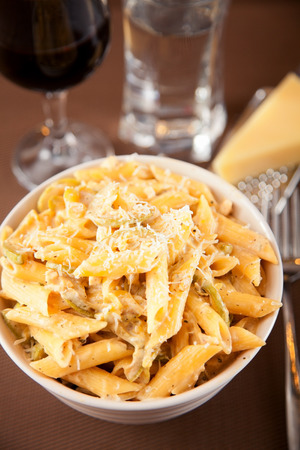 penne: Penne with cheese Stock Photo