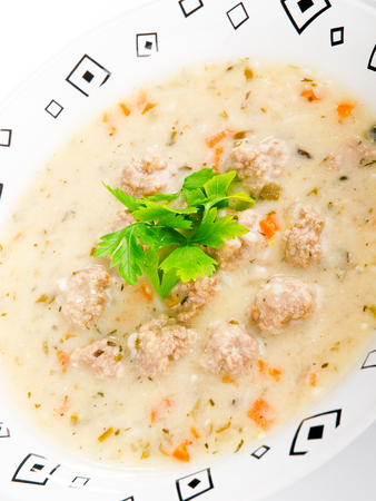 a portion: Portion of soup with meatballs in a plate Stock Photo