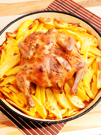 whole chicken: Baked whole chicken and potatos
