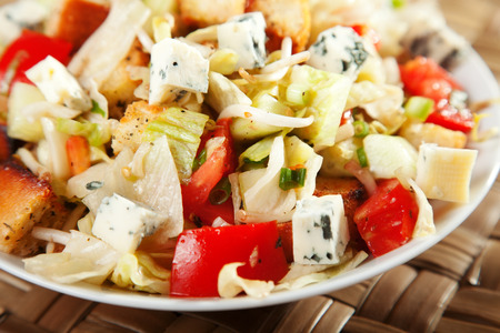 crouton: Salad with tomatos, blue cheese and croutons Stock Photo