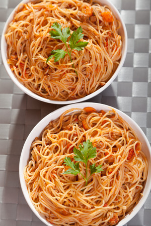 portions: Spaghetti bolognese - two portions ready-to-eat.