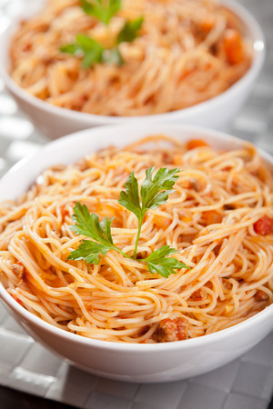 portions: Spaghetti bolognese - two portions ready-to-eat Stock Photo