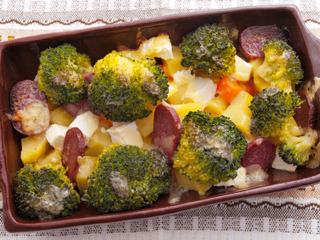 brocolli: Brocolli and potato casserole in a baking dish on the table Stock Photo