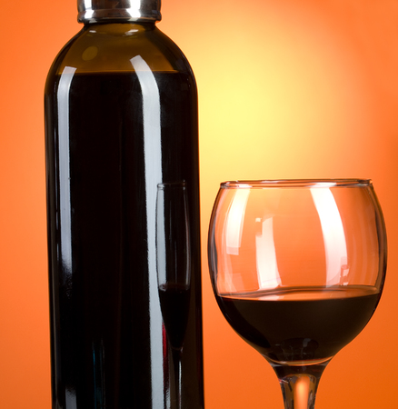 redwine: Bottle and glass of red wine