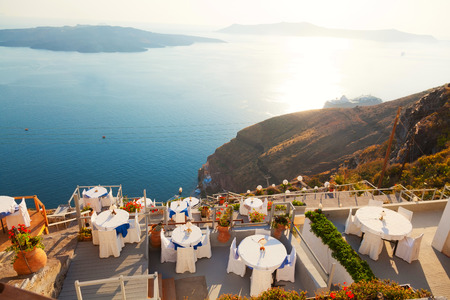 dinner cruise: Local restaurant in Fira with a view to the sea Stock Photo