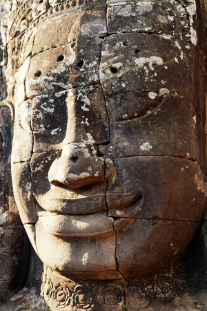 bayon: large stone carved faces of Bayon Temple in Angkor Thom, Angkor district, Siem Reap, Cambodia