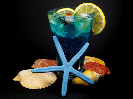 oz: Ingredients:  1 oz vodka 1 oz Blue Curacao liqueur lemonade 1 lemon slice 1 cherry