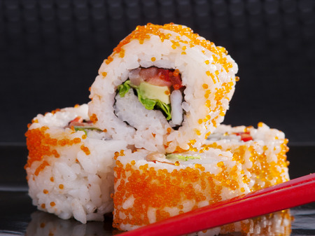 upperdeck view: Close up of a portion Uramaki sushi