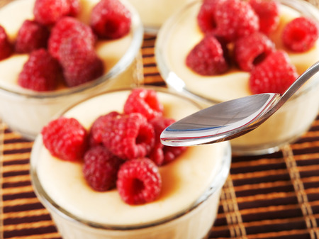 portions: Vanilla cream with raspberries, four portions, close up