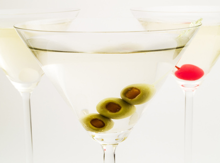 vermouth: There are many variations of martinies. Those three are the most popular - dry, sweet and medium. The classical, dry martini should be made with dry vermouth and be garnished with green olives. The sweet martini is made with sweet vermouth and garnished w