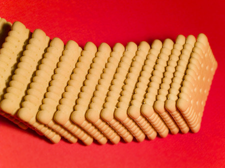 nb: Biscuits on red background Stock Photo