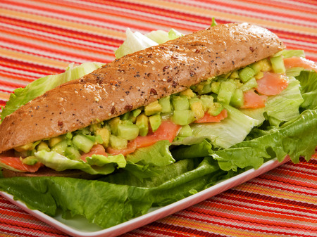 sandwitch: Sandwitch with salmon, avocado, cucumber and iceberg salad