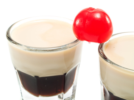 multilayered: Ingredients: 1 oz Kahlua Coffee Liqueur 1 oz Light Cream Stock Photo