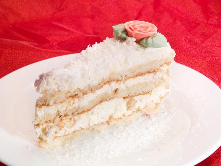 vanilla cake: Vanilla cake on red Stock Photo