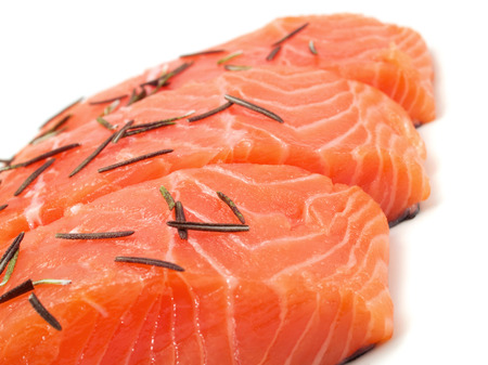 selective focus: Raw salmon with rosemary