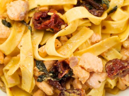 fullframe: Tagliatelle with salmon and peppers Stock Photo