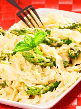 portion: Tagliatelle with asparagus and cream, one portion Stock Photo