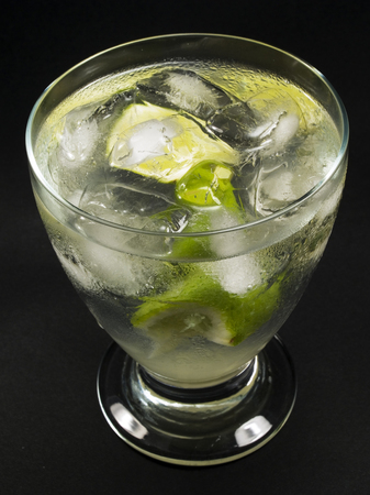 gimlet: Ingredients:  2 oz gin 12 oz lime juice lime wedges Stock Photo