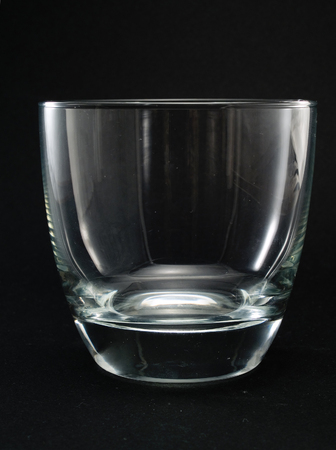 oldfashioned: Empty Old-fashioned Glass Stock Photo