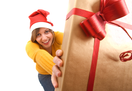 wideangle: Wide angle view of young girl holding a yellow Christmas present.