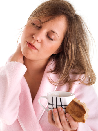 housecoat: Woman with coffee and toast Stock Photo