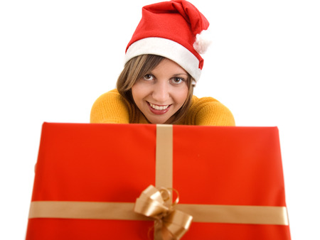 wideangle: Young woman passing a big red present toward the camera. Isolated on white background. Stock Photo