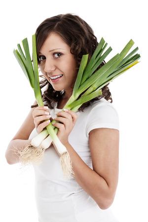 leek: Young woman with fresh leek Stock Photo